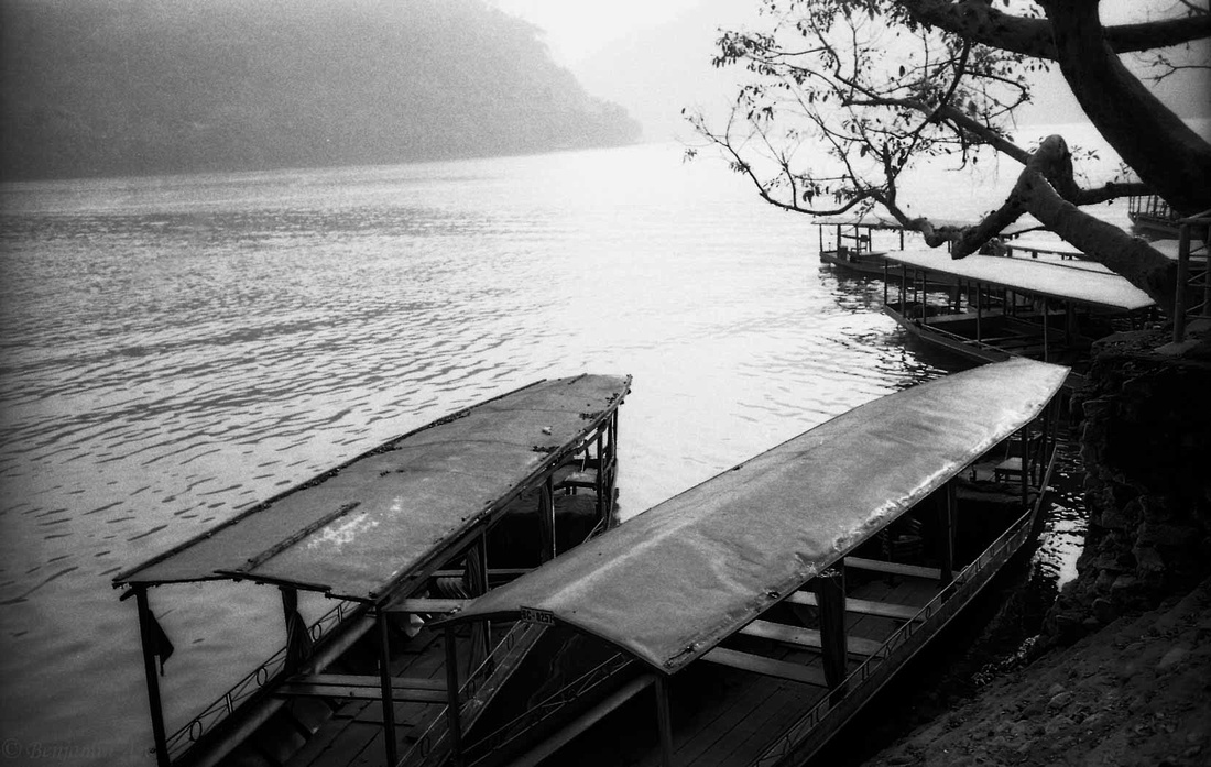 Boats at rest by the shorelines of Ba Be National Park, Hanoi, North Vietnam 2015.